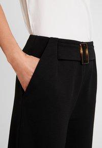 Vero Moda - VMCHARLOT CULOTTE PANT - Kalhoty - black - 4