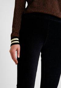 Vero Moda - VMAMANDA FLARED PANTS - Pantaloni - black - 5