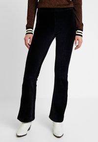 Vero Moda - VMAMANDA FLARED PANTS - Pantaloni - black - 0