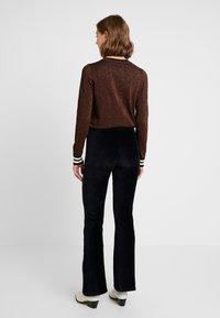 Vero Moda - VMAMANDA FLARED PANTS - Pantaloni - black - 3