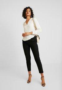 Vero Moda - VMMAISELMA PANT - Pantalon classique - black - 1
