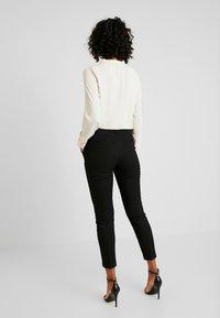 Vero Moda - VMMAISELMA PANT - Pantalon classique - black - 2
