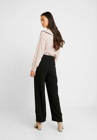 Vero Moda - VMSILLE GOIA PANTS - Trousers - black - 3