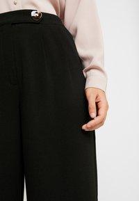 Vero Moda - VMSILLE GOIA PANTS - Trousers - black - 5