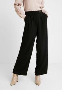 Vero Moda - VMSILLE GOIA PANTS - Trousers - black - 0