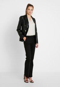 Vero Moda - VMSUSAN BOOTCUT PANT - Trousers - black - 2