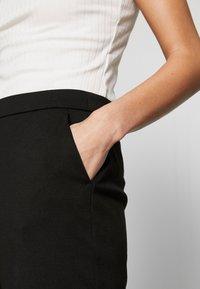 Vero Moda - VMBELLA SELMA PANTS - Kalhoty - black - 4