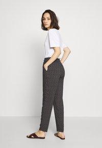 Vero Moda - VMSIMPLY EASY LOOSE PANT - Trousers - black/felicia tornado - 2