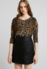 Vero Moda - VMINA SHORT SKIRT - A-Linien-Rock - black