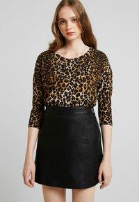 Vero Moda - VMINA SHORT SKIRT - Áčková sukně - black - 3