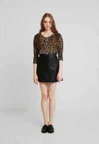 Vero Moda - VMINA SHORT SKIRT - Áčková sukně - black - 1
