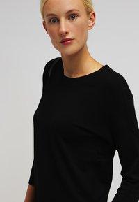 Vero Moda - VMGLORY 3/4 VIPE AURA DRESS - Stickad klänning - black - 3
