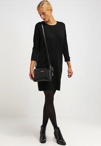 Vero Moda - VMGLORY 3/4 VIPE AURA DRESS - Stickad klänning - black - 1