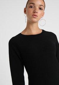 Vero Moda - VMNANCY DRESS - Pletené šaty - black - 5