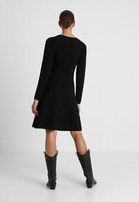 Vero Moda - VMNANCY DRESS - Pletené šaty - black - 3