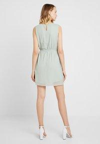 Vero Moda - VMALIA DRESS - Koktejlové šaty/ šaty na párty - light green - 2