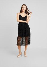 Vero Moda - VMMADELEINE CALF DRESS - Denní šaty - black - 0