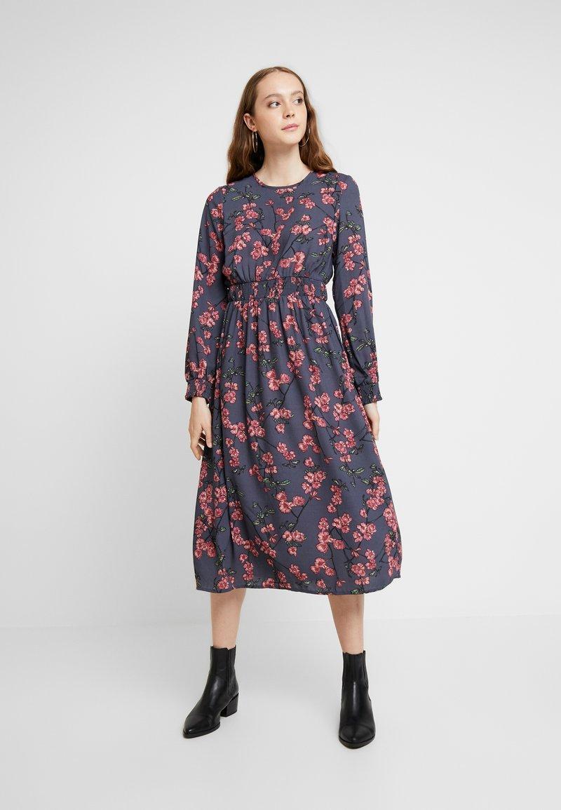 Vero Moda - VMMALLIE SMOCK DRESS - Day dress - ombre blue/mallie