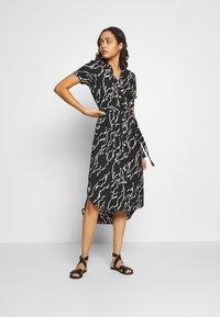 Vero Moda - VMRICA DRESS - Skjortklänning - black/rica - 1