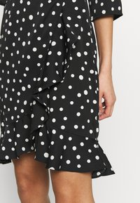 Vero Moda - VMHENNA WRAP DRESS - Vapaa-ajan mekko - black/white - 3