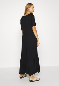 Vero Moda - VMMITSI V-NECK ANCLE DRESS - Maxi-jurk - black