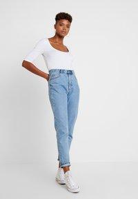 Vero Moda - VMPANDA CROSS  - T-shirt med print - bright white - 1
