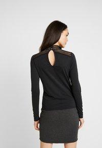 Vero Moda - VMLILJA HIGHNECK - Long sleeved top - black - 2