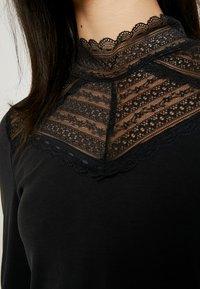 Vero Moda - VMLILJA HIGHNECK - Long sleeved top - black - 5