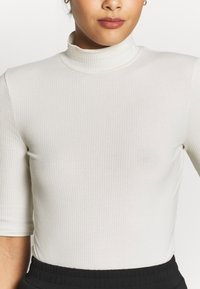 Vero Moda - VMISLA 2/4 HIGH NECK TOP GA VO - T-shirt basic - birch - 4
