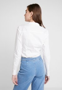 Vero Moda - VMLADY - Button-down blouse - snow white - 2
