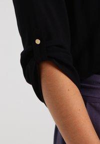 Vero Moda - VMBUCI 3/4 FOLD UP - Bluse - black - 3