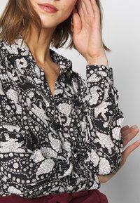Vero Moda - VMLUCIA - Button-down blouse - black - 4