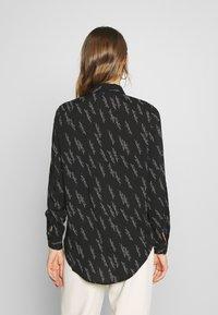 Vero Moda - VMGUNHILD - Button-down blouse - black - 2