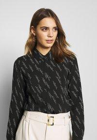 Vero Moda - VMGUNHILD - Button-down blouse - black - 3