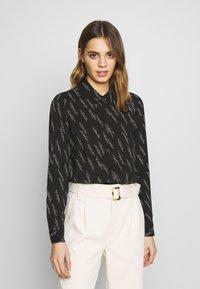 Vero Moda - VMGUNHILD - Button-down blouse - black - 0