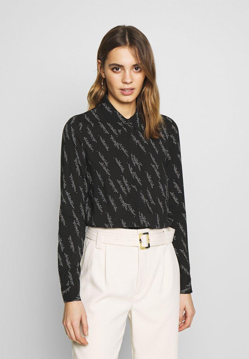 Vero Moda - VMGUNHILD - Button-down blouse - black