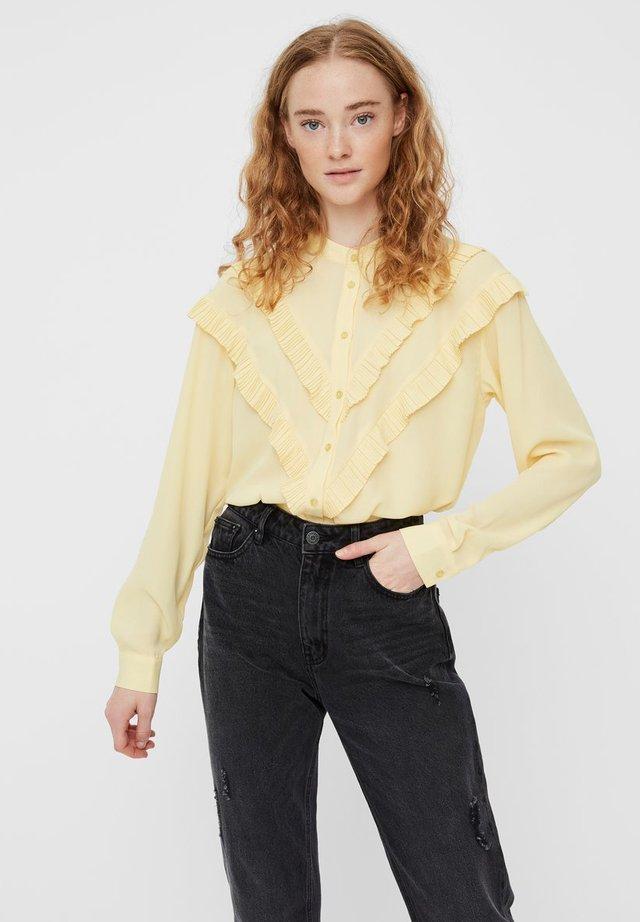 Skjorta - pale banana