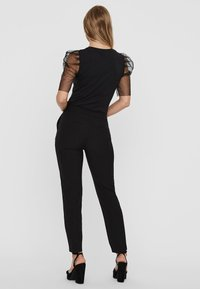 Vero Moda - T-shirt con stampa - black - 2