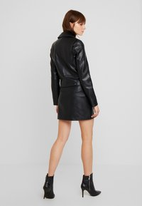 Vero Moda - VMCOOL SHORT COATED JACKET - Giacca in similpelle - black - 2