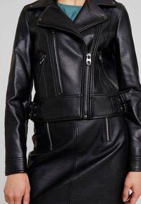 Vero Moda - VMCOOL SHORT COATED JACKET - Chaqueta de cuero sintético - black - 4