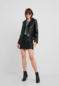 Vero Moda - VMCOOL SHORT COATED JACKET - Faux leather jacket - black - 1