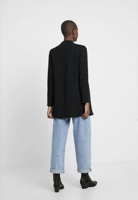 Vero Moda - VMBRINE LONG - Short coat - black - 2