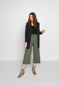 Vero Moda - VMJANEY - Krátký kabát - black - 1