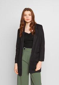 Vero Moda - VMJANEY - Krátký kabát - black - 0