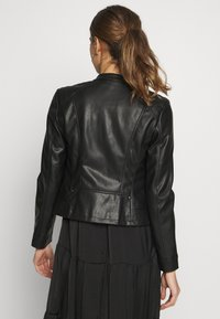 Vero Moda - VMBUTTERYOU  - Faux leather jacket - black - 2