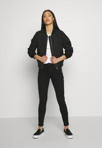 Vero Moda - VMMIRABELLE  - Light jacket - black - 1