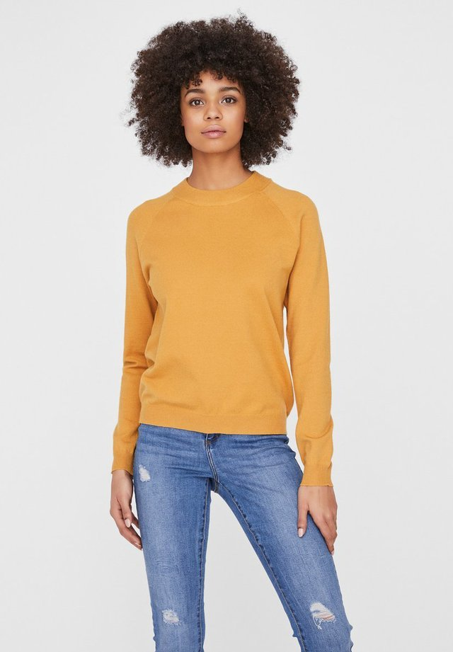 Stickad tröja - amber gold