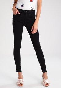 Vero Moda - VMSEVEN - Trousers - black - 0