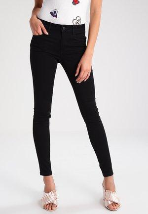 VMSEVEN - Trousers - black