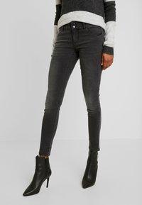 Vero Moda - VMLUCIA - Jeans Skinny Fit - black - 0